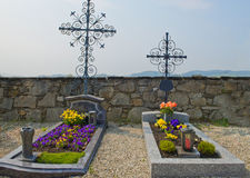 Grave. With a cross and flowers Stock Photos