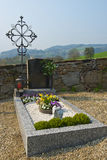Grave. With a cross and flowers Stock Photography