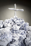 Grave with cross made of crumpled papers Royalty Free Stock Photo