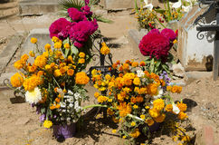Grave decorated with flowers Stock Photos
