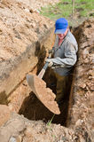 Grave digger at work Stock Photography