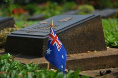 Grave and flag. Australian flag on the ledger Royalty Free Stock Photography
