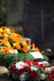 Grave with flowers. A grave with flowers right after the funeral Royalty Free Stock Photos