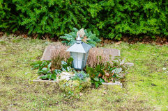 Grave with lantern Royalty Free Stock Photos
