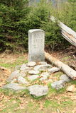 Grave of last bear on Sumava. Symbolical grave (Barenstein) of the last bear living and hunted on Sumava (Czech Republic stock images