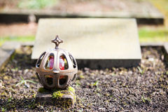 Grave light. With an empty gravestone in the back Stock Photography