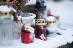 Grave lights in snow royalty free stock images