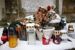 Grave lights in snow royalty free stock photo