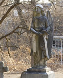 grave marker carved in the shape of an angel Stock Photos