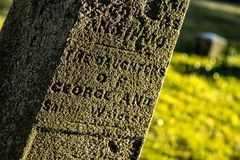Grave Marker at an Old Cemetery. A grave marker stands in the late afternoon light in an old Cemetery in Rochester, New York, July 2018 Royalty Free Stock Photos