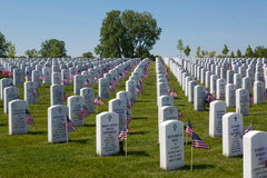Grave Markers. A photo of grave markers at the Great Lakes National Cemetery. Each grave is marked with a small American flag for Memorial Day Royalty Free Stock Photos