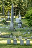 Grave Markers at an Old Cemetery. Grave markers and headstones stand i the light afternoon light in an old Cemetery in Rochester, New York, July 2018 Royalty Free Stock Photography