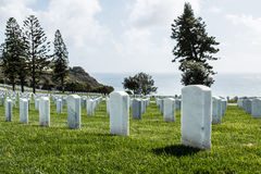 Grave Markers with an Ocean Background at Fort Rosecrans National Cemetery Royalty Free Stock Photography