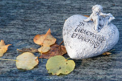 Grave ornament with heart in autumn with german text Stock Images
