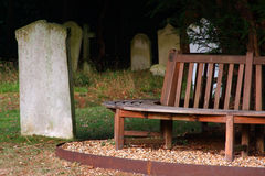 Grave Resting Place. Graveyard with gravestone and bench for sitting royalty free stock images