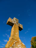 Grave Stone Cross against blue sky Stock Photos