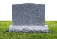 Grave Stone on Green Grass. An uninscribed grave stone standing on green grass, back isolated on white royalty free stock image