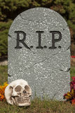 Grave Stone with skull. A Halloween grave stone decoration Royalty Free Stock Image