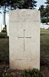 Grave stone of unknown soldier. Grave of unknown solder with the inscription  ' A victim of the second world war ' and a Christian cross then ' Known unto God Stock Photography