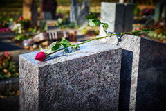 Grave stone with withered rose Royalty Free Stock Photos