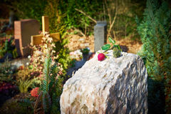Grave stone with withered rose Royalty Free Stock Images