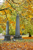 Grave Stones. Obelisk Shaped Grave Stones Surrounded By The Beautiful Colors Of Autumn royalty free stock photos
