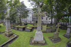 Grave stones in Aberdeen. Wide angle view of Grave stones in a cemetery at the Kirk of Saint Nicholas Uniting in Aberdeen, Scotland stock image