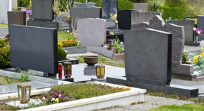 Grave stones at a cemetery. Graves with grave stones at a cemetery in spring stock image