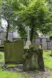 Grave stones. And green trees at the Kirk of Saint Nicholas Uniting stock photo