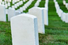 Grave stones on a peaceful cemetery. Grave stones on a peaceful cemetery, selective focus on a front stone stock image