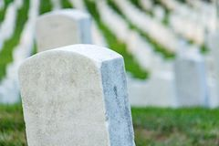 Grave stones on a peaceful cemetery. Grave stones on a peaceful cemetery, selective focus on a front stone stock photos