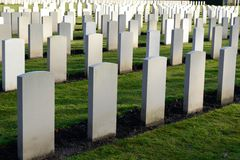 Grave stones remember. Cemetery with many white grave stones stock photography