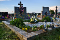Grave / tombstone in the cemetery / graveyard. All Saints Day / All Hallows / 1st November Royalty Free Stock Photos