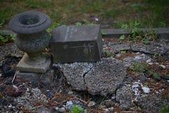 Grave vase. Grave vase on destroyed grave Royalty Free Stock Photography