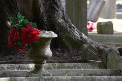 Grave vase. Grave vase with red flowers on the headstone Stock Photography