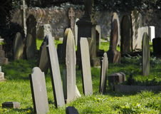 Grave yard head stones. Old grave yard with old grave head stones stock photo