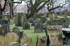 Grave Yard Stones. Rows and rows of ancient grave stones in the church yard royalty free stock image