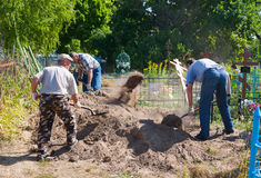 Gravediggers digging the grave in Bestuzhevo village Stock Images