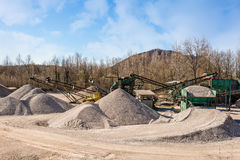 Gravel aggregate extraction. Machinery distribution and classifi Royalty Free Stock Photos