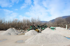 Gravel aggregate extraction. Machinery distribution and classifi Royalty Free Stock Images