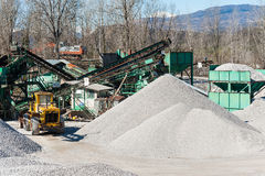Gravel aggregate extraction. Machinery distribution and classifi Royalty Free Stock Photography