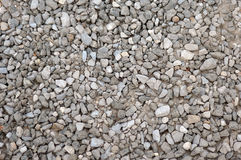Gravel aggregate seamless background. Grey gravel aggregate background with garbage Royalty Free Stock Image