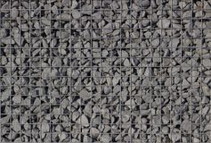 Gravel background in a gabion close-up stock photography