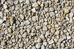 Gravel background up close. Close up of medium sized stone gravel fillng the image. Suitable as a background or wallpaper Stock Images