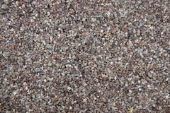 Gravel in beige rown and grey tones - background texture Royalty Free Stock Photography