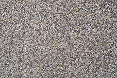 Gravel in cement wall as background. Stock Photo