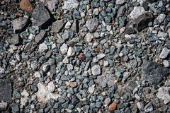 Gravel with colorful rocks. Gravel and light vignetting. Many different small rocks Stock Image