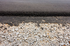 Gravel and concrete asphalt of road paving. Royalty Free Stock Photography