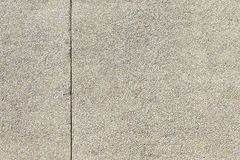 Gravel concrete wall with crack, texture or background Stock Image