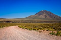 Gravel and corrugated road through Argentinia. Famous Ruta 40 called also Ruta Quarenta passing through plains and mountain valleys in northern part Argentina Stock Images